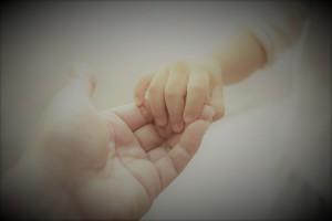 mum-holding-baby-hand-1680x1120